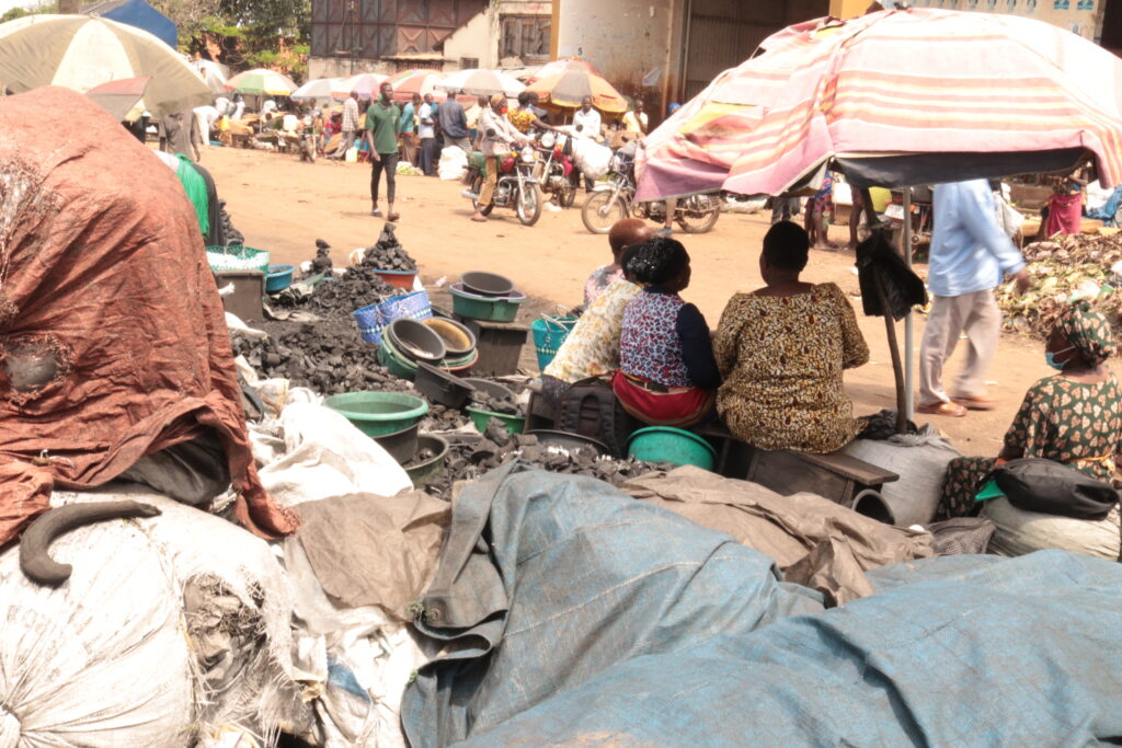 harcoal-traders-converse-as-they-wait-for-clients
